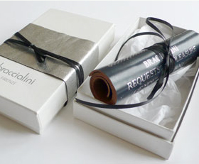Leather scroll invitation design by Park Studio